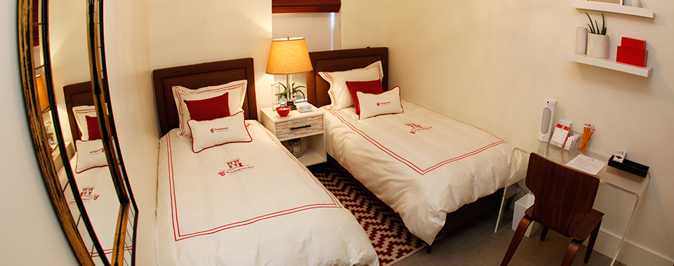 A bedroom at the Pomegranate Suites